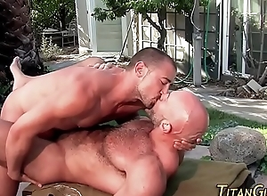 Hung bear cums outdoors
