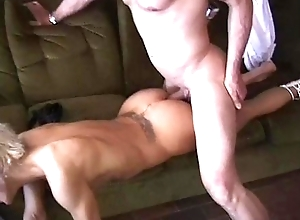 A young blonde is confoundedly banged by two men